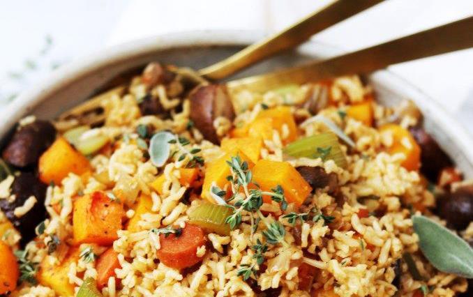 Bowl of brown rice, orange sweet potatoes & carrots, sage, thyme