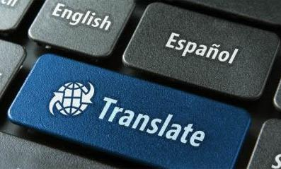"Blue ""Translate"" computer button surrounded by gray buttons displaying language choices: ""English,"" ""Espanol,"" ""Francais,"" etc."