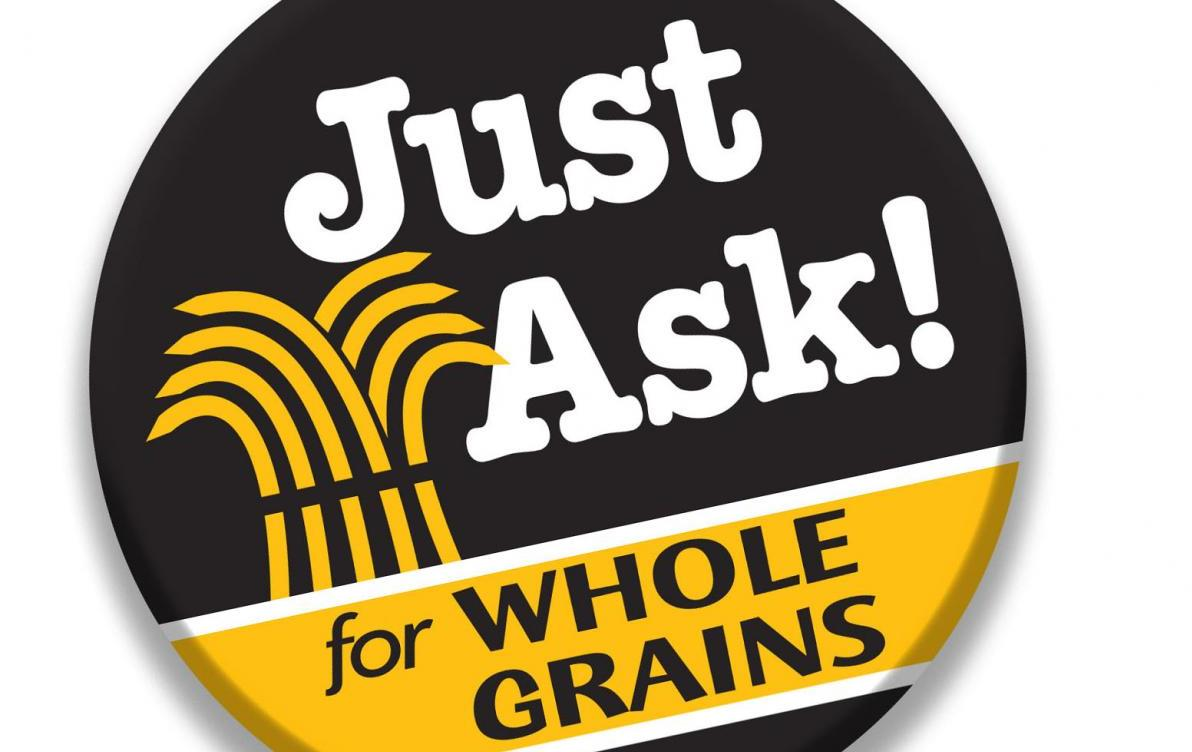 "Black button with text ""Just Ask for Whole Grains"" and golden sheath of grains"