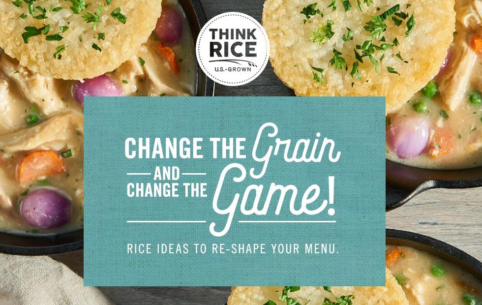 "Background photo is three iron skillets filled with chicken, carrots, peas, and onions are topped with fried rice cakes, text block reads ""Change the Grain and Change the Game!"""