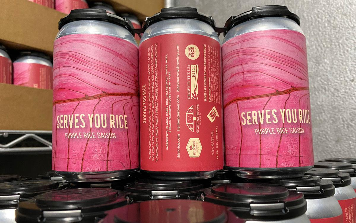 Serves You Rice beer cans with bright pink labels and US Grown logos