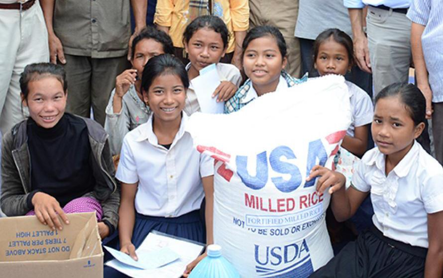 Children-with-sack-of-US milled-rice