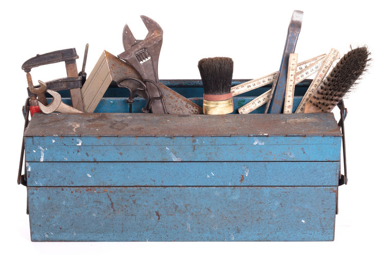 Blue toolbox with variety of implements: wrenches, brushes, screwdrivers, rulers