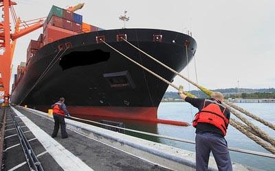 Cargo ship tying in at port