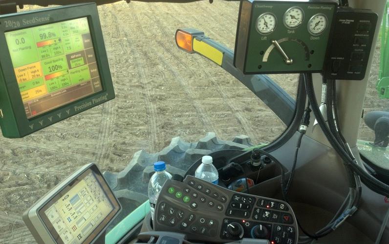 Multiple screens inside combine cab