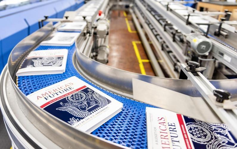 FY2021 Budget on conveyor belt