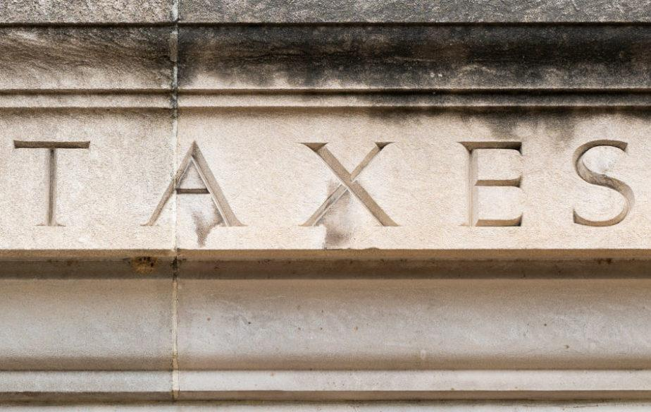 Taxes engraved on building fascade