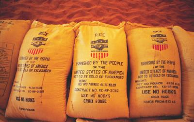 Stacks of USAID rice bags