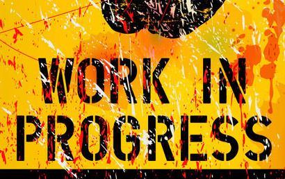 Orange Work-in-Progress sign