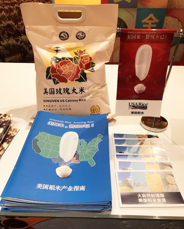 Sample bag of Calrose on table with brochures at Chinese trade show