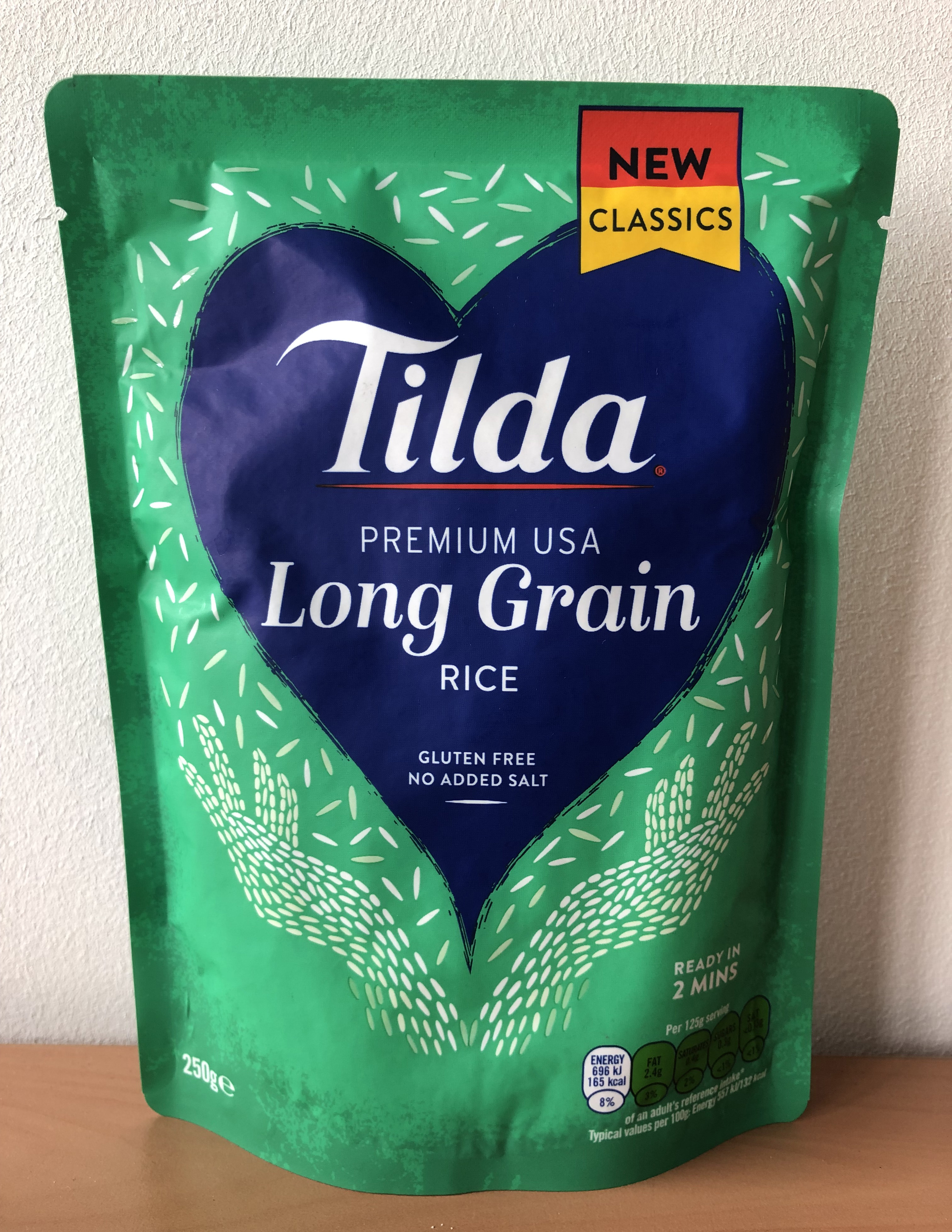 """Green package with blue heart in the center with text """"Tilda Long Grain Rice"""""""