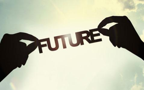 "The word ""future"" held up by two hands, silhouetted against a bright sky"