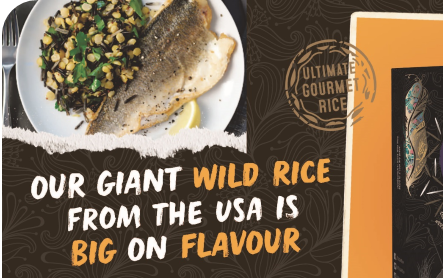 Giant wild rice promo shows rice, piece of fish, and lemon on a white plate with text