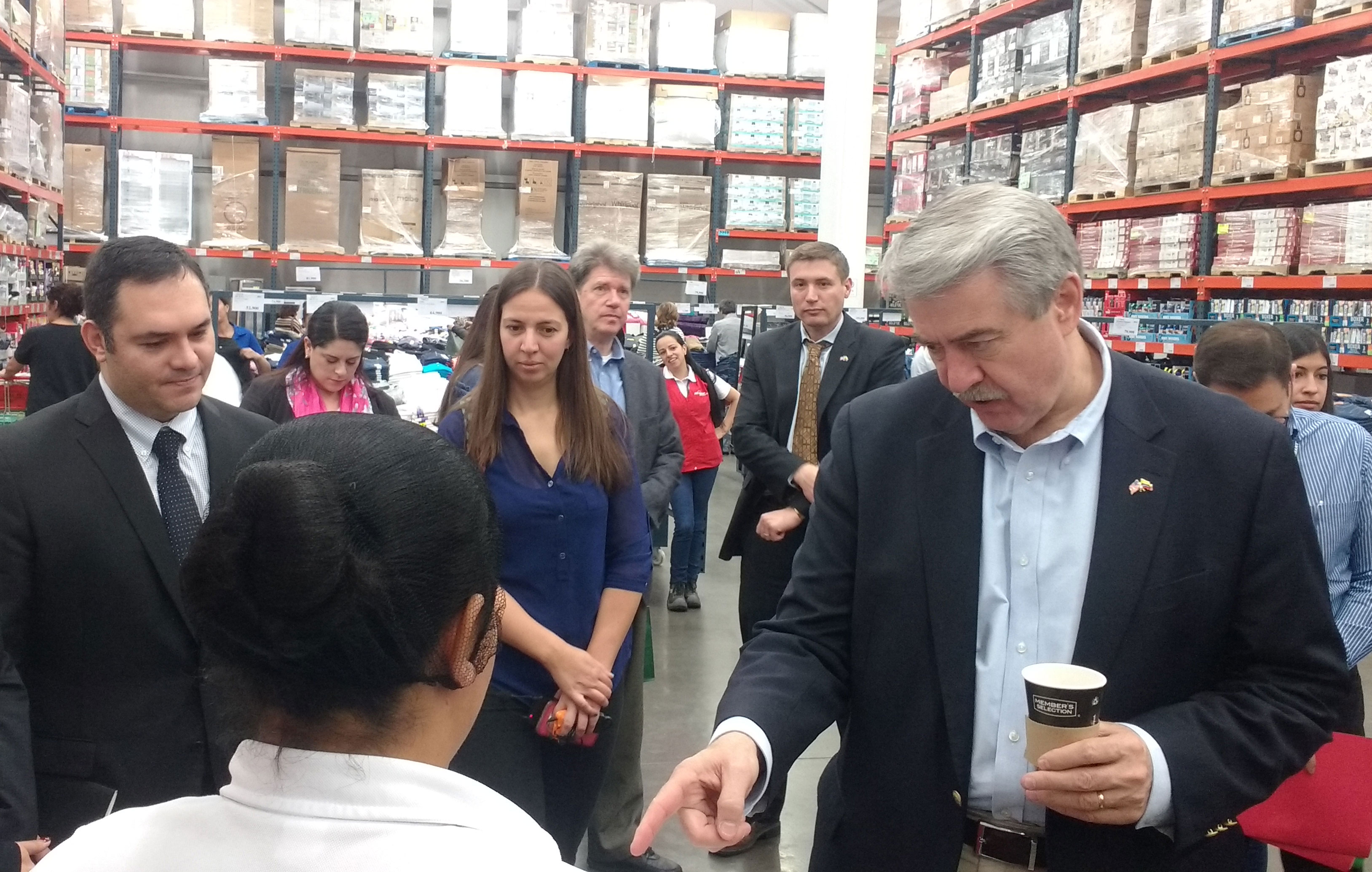 Group of people, including USDA-Undersecretary for Trade-Ted McKinney, shop at wholesale club store-in-Colombia