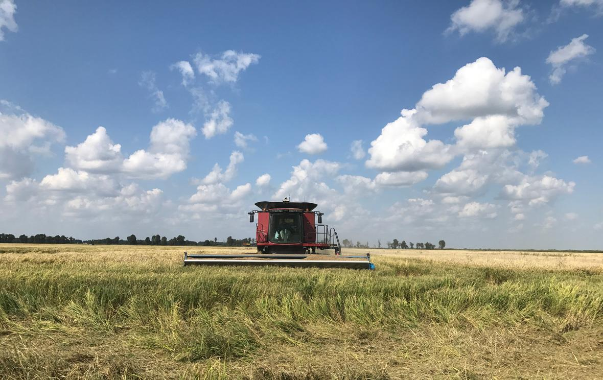 Red-combine-with-puffy-clouds