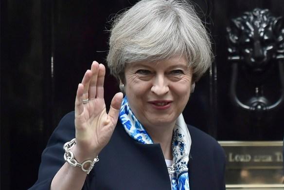British Prime Minister Theresa May waves goodbye