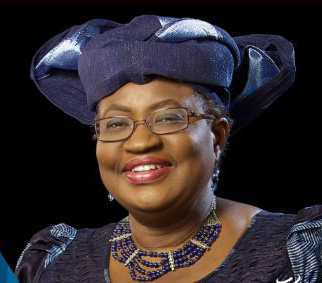Dr. Ngozi Okonjo-Iweala, black woman wearing glasses and cloth headdress that matches her dress