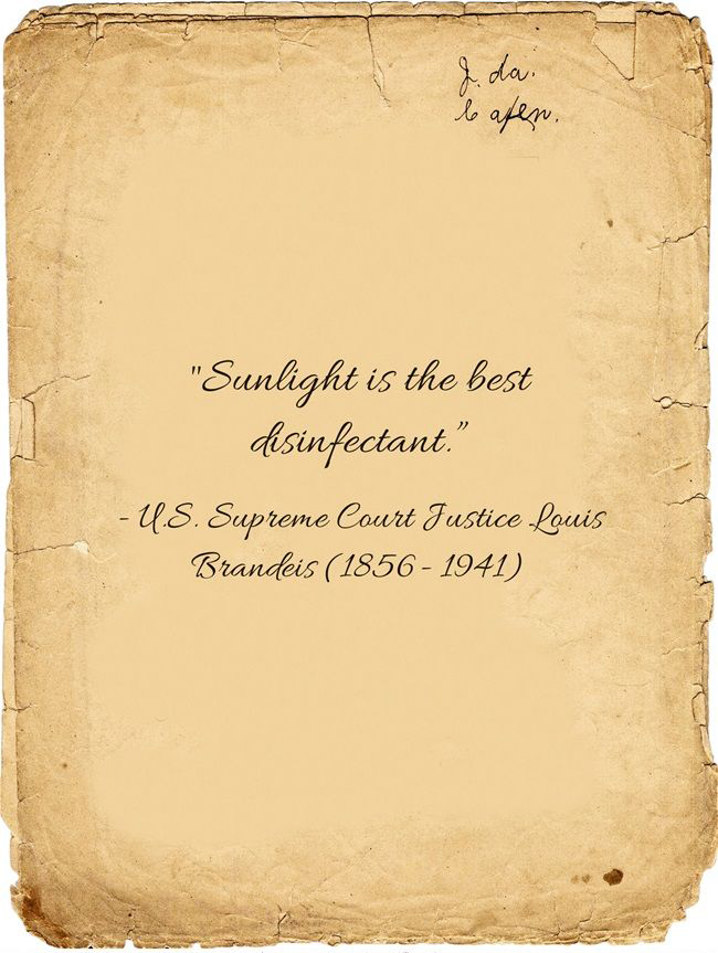 """Text """"Sunlight is the best disinfectant"""" on yellowed book page"""