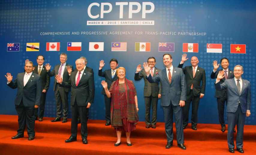 Group shot of CPTPP trade partners standing on stage beneath respective country