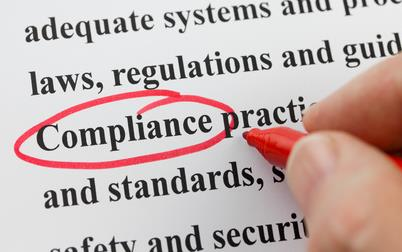 """Word """"compliance"""" circled in red ink"""