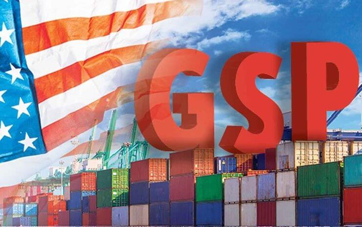 Shipping containers and American flag in background behind red capital letters G-S-P