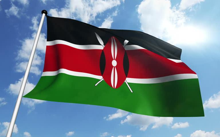 Kenya flag - black, red, and green stripes with red shield and white spears in the middle