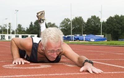 Old man crawls across finish line at track meet