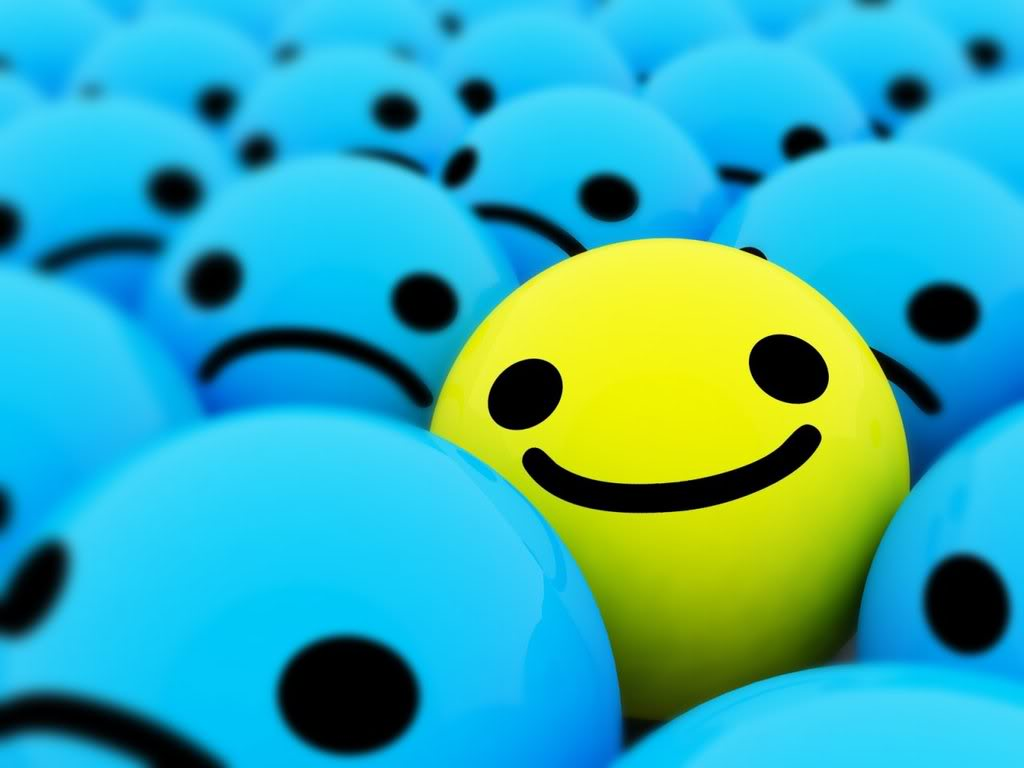 Yellow smiling circle in midst of crowd of blue frowning circles