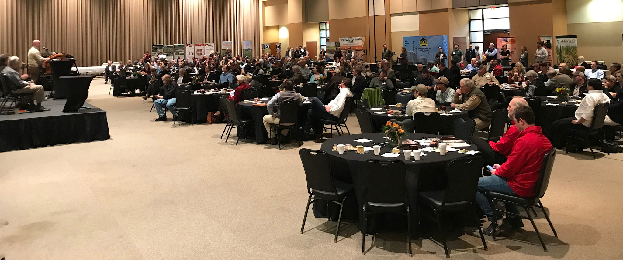 AR State meeting, crowd shot of people sitting at round tables draped in black tablecloths