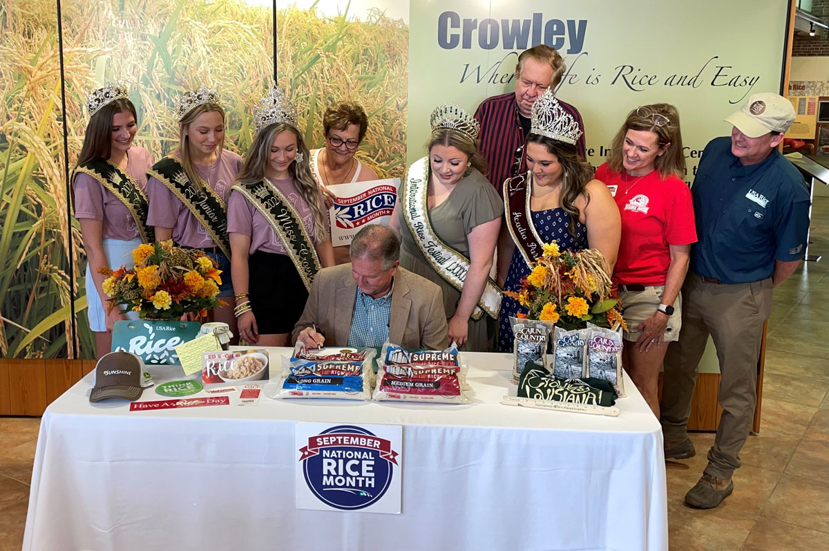 Mayor-Monceaux-Signing-NRM-Proclamation, surrounding by Rice Queens