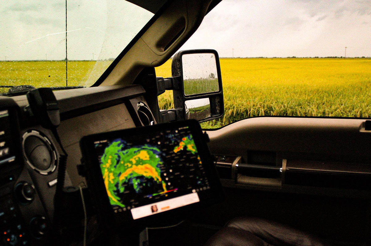 Storm-tracker-visible in truck parked next-to-mature-AR-rice-field,-C. Wright photo