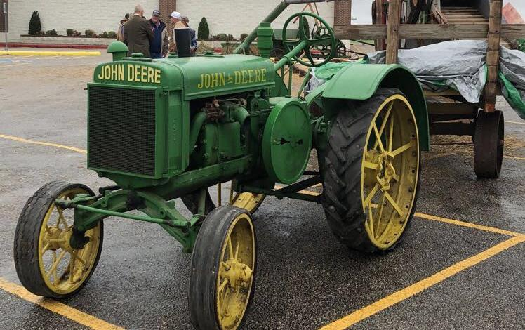 Antique John Deere tractor parked outside El Campo Museum of Natural History