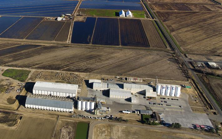 Aerial shot of ACC rice mill and surrounding flooded rice fields & Sutter Buttes