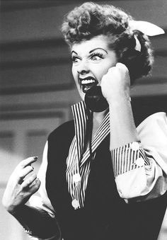 black and white movie screenshot talking on the phone