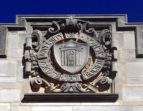 UofA seal carved in stone on campus ag building