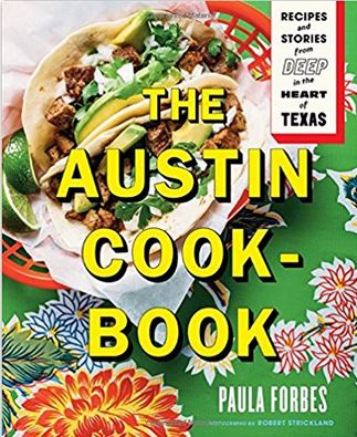 Cover of The Austin Cookbook shows red plastic takeout basket holding tortilla filled with beef, avocado & cilantro on colorful tablecloth