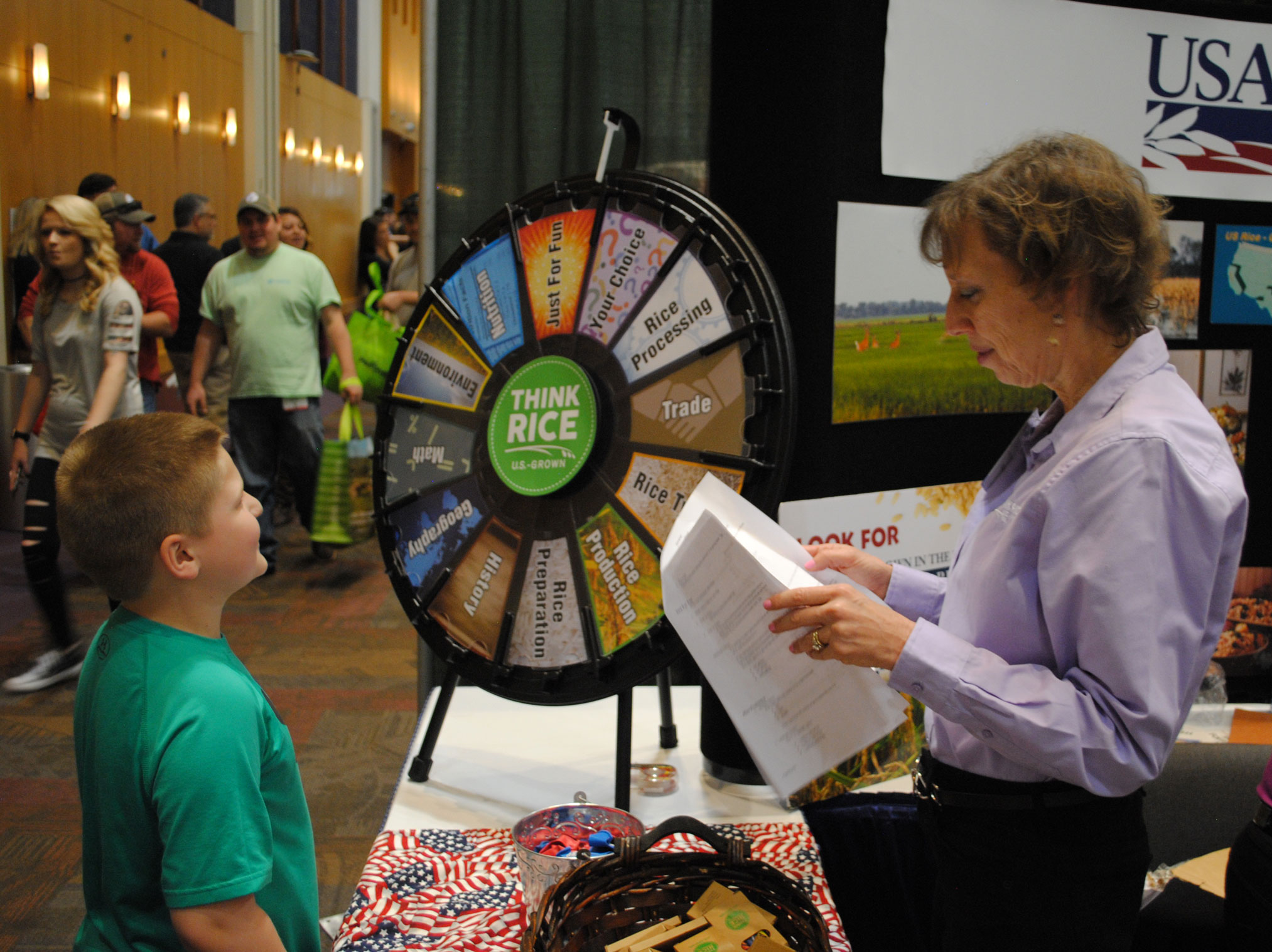 Young boy plays prize wheel trivia at 2018-Gin-Show