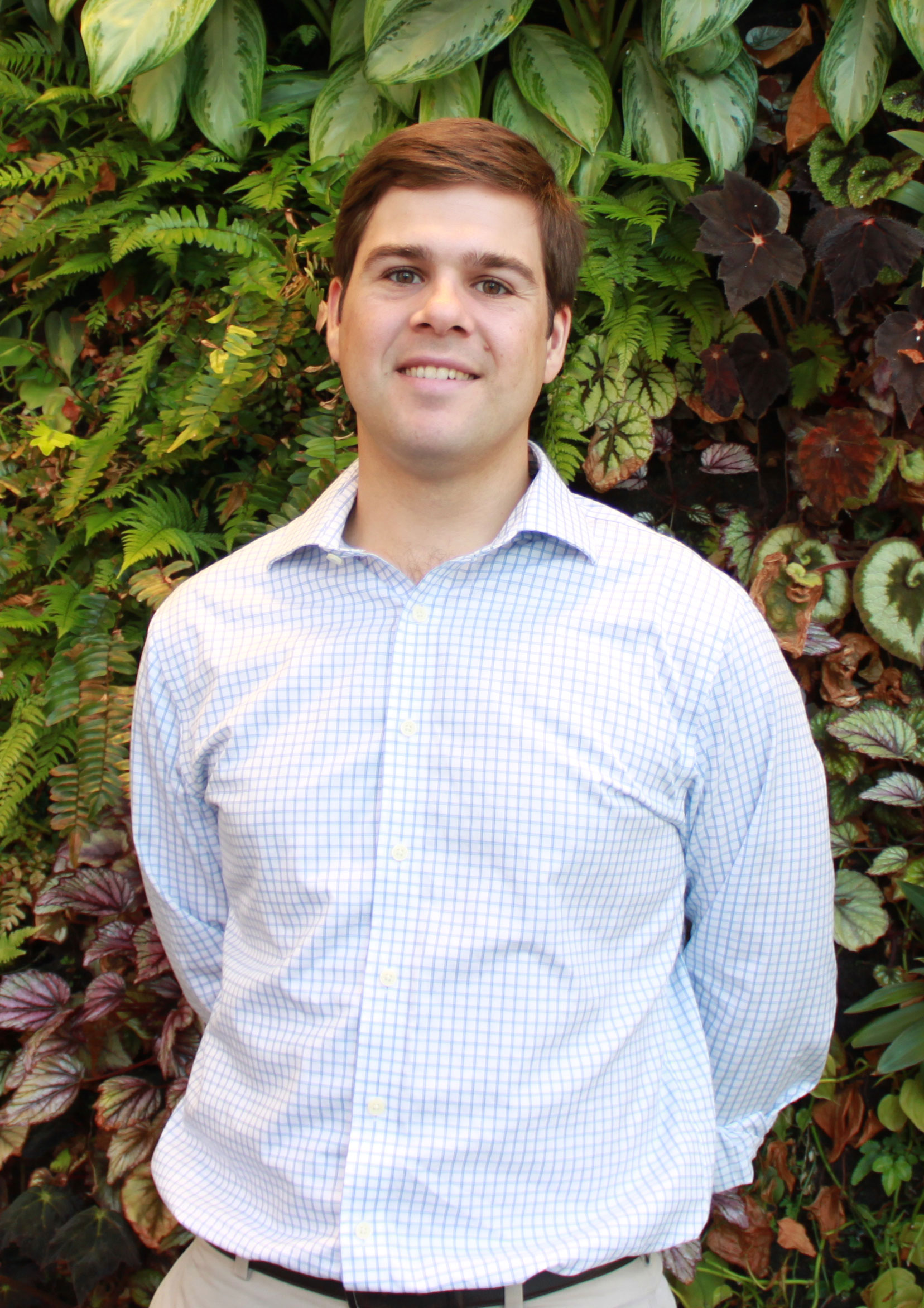 Headshot of USA Rice Manager of Government Affairs Frank Leach in front of living plant wall