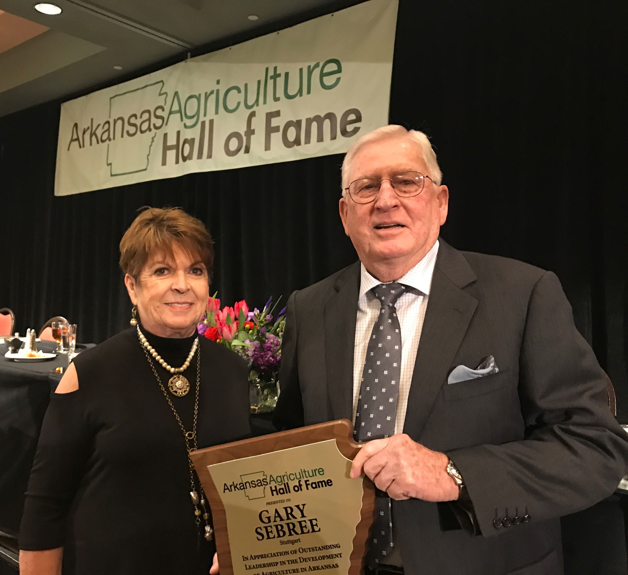 Gary-Sebree-holds his Ag-Hall-of-Fame plaque