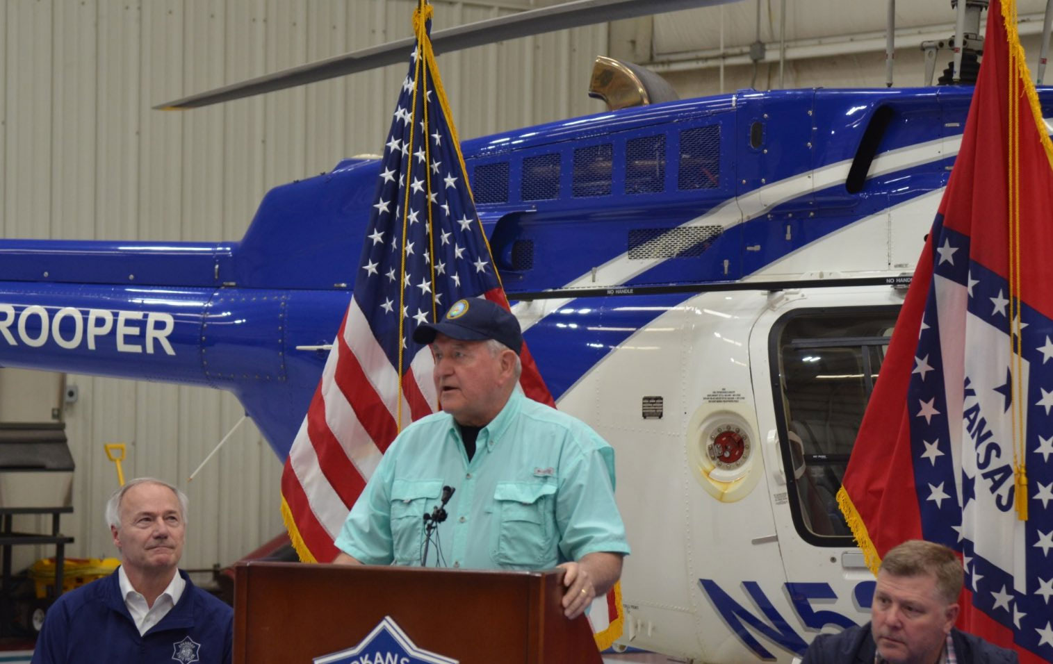 Secretary of Ag Sonny-Perdue-standing in front of rescue helicopter during press conference about 2017 AR flood