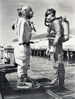Deep Sea Divers standing on a dock
