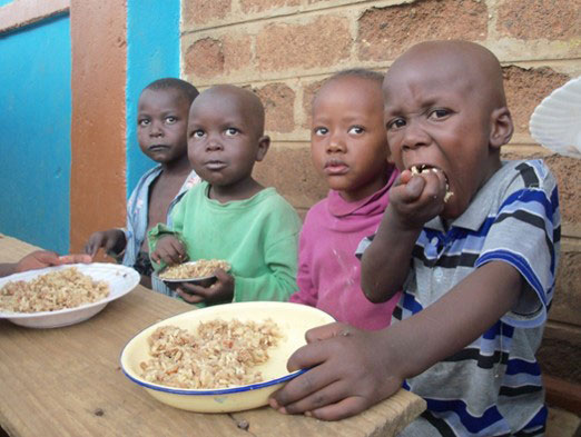 Children-Eating-Bowls-of-Rice,-Food-Aid