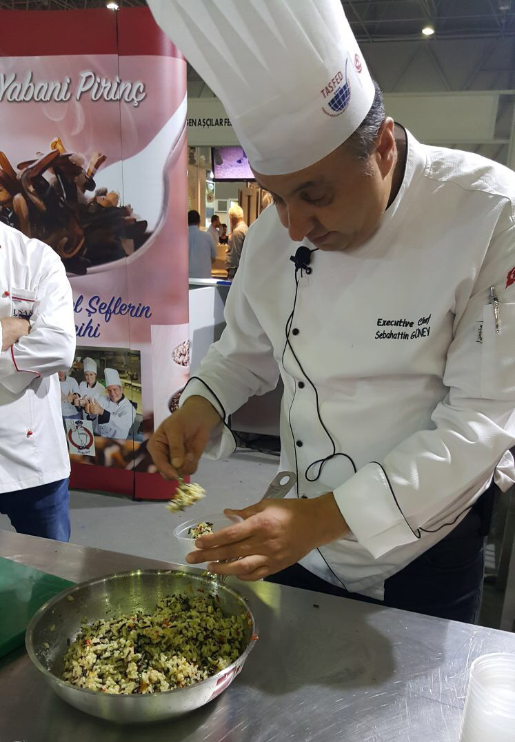 Chef at Turkey Trade Show preparing rice dish