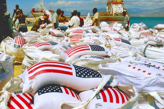 US rice-bags-with American flag being unloaded from a ship