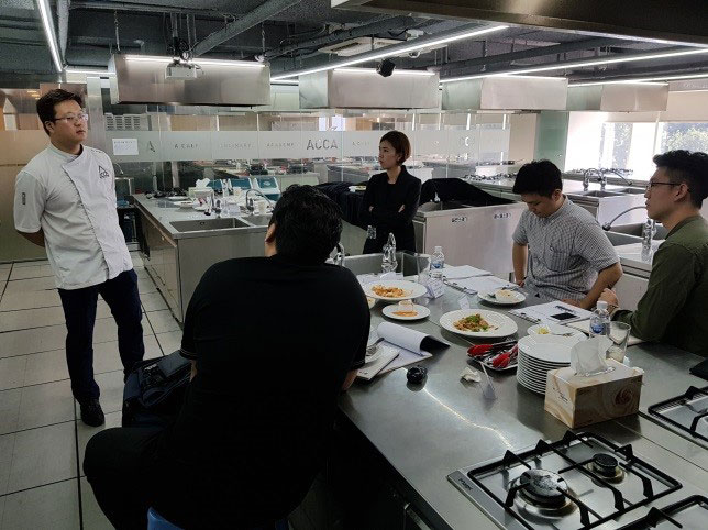 Chef in professional kitchen presents new menu ideas for South-Korea-Foodservice-program