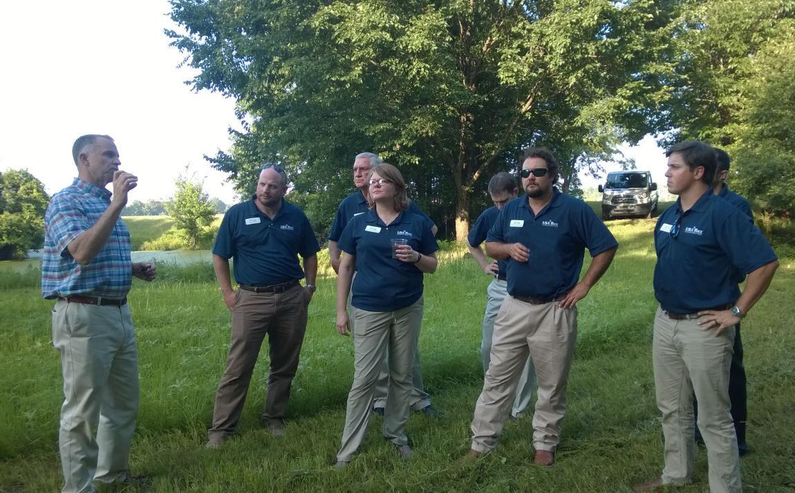 Leadership Class at George Dunklin duck camp, standing in rice field