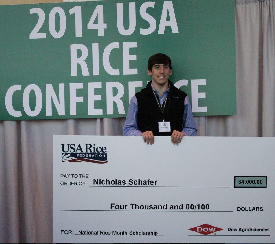 2014 NRM Scholarship winner Nicholas Schafer holds big $4K check