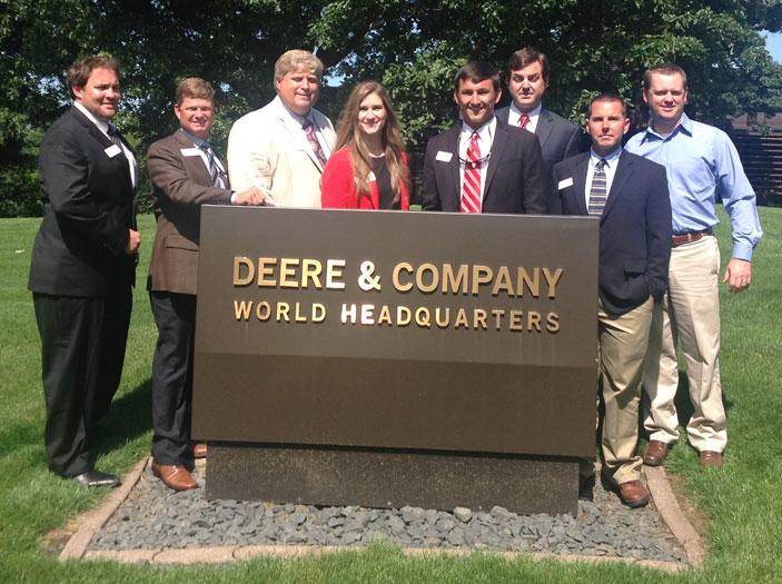 Leadership class group shot around Deere & Company World Headquarters sign