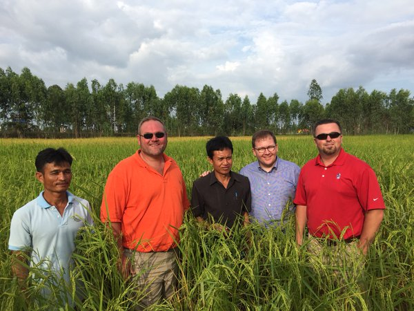 Leadership Class in Thailand- stand with local farmers in rice field