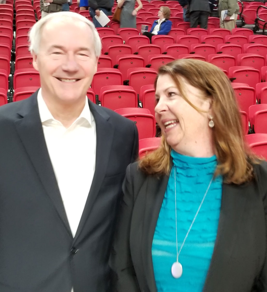 CEO Betsy Ward standing next to AR Gov-Asa Hutchinson